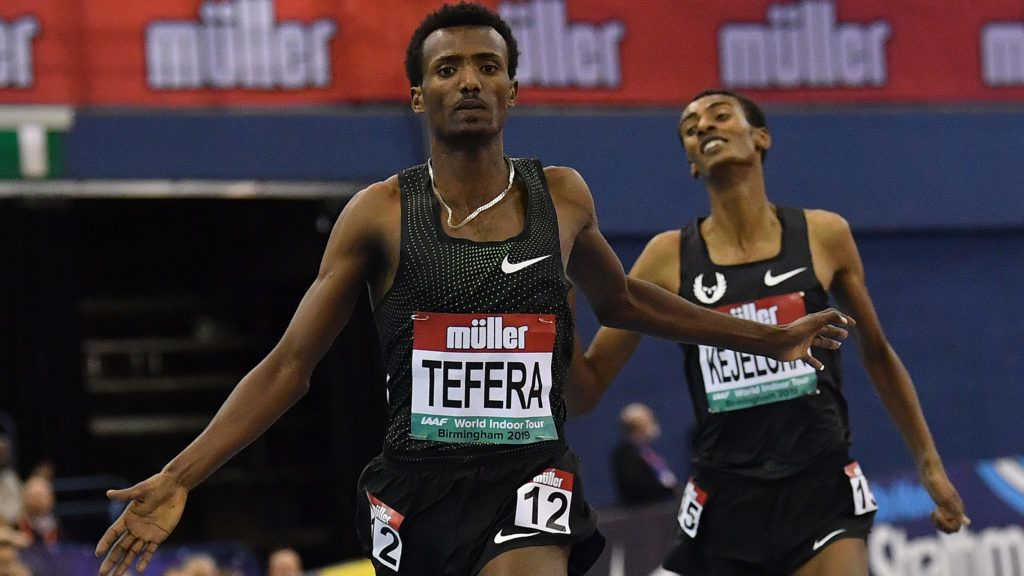 Ethiopia's Samuel Tefera (L) competes to break the indoor world record and win the men's 1500m final ahead of Ethiopia's Yomif Kejelcha at the Indoor athletics Grand Prix at Arena Birmingham in Birmingham on February 16, 2019. (Photo by Ben STANSALL / AFP)