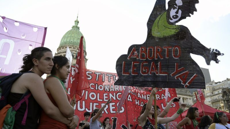 """Activists demanding the legalization of legal, safe and free abortion take part in a demonstration during the so-called """"Green Action Day for the Right to Abortion"""", in front of the National Congress in Buenos Aires on February 19, 2019. - The demonstration is being held on the first anniversary of massive protests throughout the country that demanded that a bill to legalize abortion during the first 14 weeks of pregnancy would be debated in parliament. The Lower House voted in favour but the Senate voted against it. (Photo by Juan MABROMATA / AFP)"""