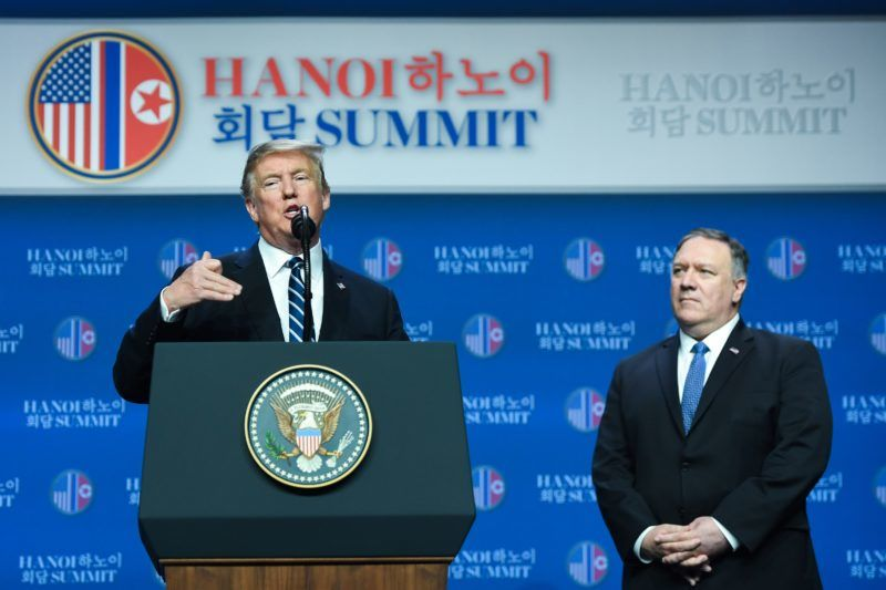US President Donald Trump (L) speaks as US Secretary of State Mike Pompeo looks on during a press conference following the second US-North Korea summit in Hanoi on February 28, 2019. - The nuclear summit between US President Donald Trump and Kim Jong Un in Hanoi ended without an agreement on February 28, the White House said after the two leaders cut short their discussions. (Photo by Saul LOEB / AFP)