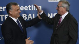 EU Commission president Jean-Claude Juncker (R) greets Hungarian Prime Minister Viktor Orban ahead of an EU-Balkans mini summit at the EU headquarters in Brussels on October 25, 2015. European Union and Balkan leaders faced a make-or-break summit on the deepening refugee crisis after three frontline states threatened to close their borders if their EU peers stopped accepting migrants. AFP PHOTO / JOHN THYS (Photo by JOHN THYS / AFP)