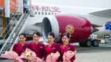 """Chinese crew members stand in front of the Boeing 787-9 Dreamliner of Juneyao Airlines after its maiden flight from Shanghai to Shenzhen at the Shenzhen Bao'an International Airport in Shenzhen city, south China's Guangdong province, 26 October 2018.   Boeing delivered the first Boeing 787-9 Dreamliner for Shanghai-based Juneyao Airlines on October 20. The new, super-efficient Dreamliner is the first widebody commercial jet operated by a privately-held Chinese airline. """"This delivery is our airline's biggest milestone and marks a big step toward expanding our network in China and beyond,"""" said Wang Junjin, Chairman, Juneyao Airlines. """"As the market-leading widebody model, the 787-9 Dreamliner will play a key role in our global business growth."""""""