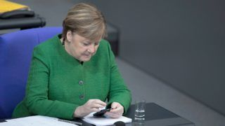 18 January 2019, Berlin: Chancellor Angela Merkel (CDU) sits in the plenary session of the German Bundestag and looks at her smartphone. The main topics of the 74th session of the 19th legislative period are the draft bill of the Federal Government for improvements in transplantation medicine, the Brexit transitional law and the planned amendment of the Federal Immission Control Act to avoid driving bans. Photo: Carsten Koall/dpa