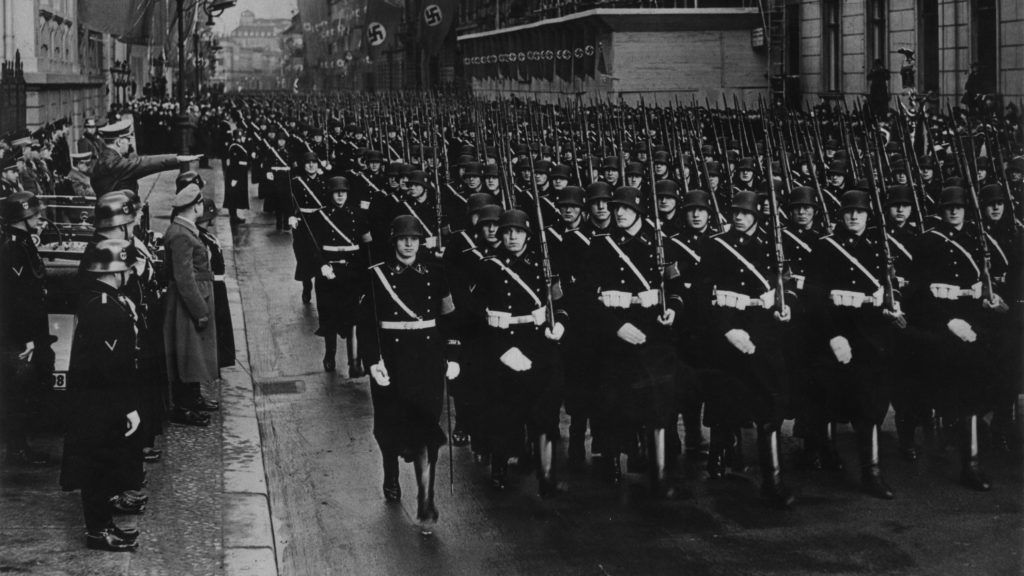 Parade of the SS Leibstandarte, the most important division of the Waffen-SS, between Berlin's streets in the presence of the Chancellor of the Third Reich Adolf Hitler. Berlin, 30th January 1938  ©MP/Portfolio/Leemage