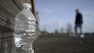 Disregarded water bottle found at Warminster community park, located at the former Naval Air Warfare Center Warminster, in Bucks County, Pennsylvania, USA  on February 6, 2019. The United States Environmental Protection Agency (EPA) is expected to release updates on tests of per- and polyfuoroalkyl substances or PFAs pollution in public water supplies for 16 million Americans in 33 states, including Pennsylvania. The federal report is delayed due to January 2019 shutdown. Reps. Brian Fitzpatrick, Republican of Bucks County in Eastern Pennsylvania and Democrat Dan Kildee, of Michigan cochair a bipartisan task force in the House of Representatives, formed to take on the growingPFAS ContaminationCrisis. The usage of foam at nearby former military bases is linked to tainted drinking water, affecting tens of thousands of residents in Bucks and Montgomery Counties in Eastern Pennsylvania. (Photo by Bastiaan Slabbers/NurPhoto)