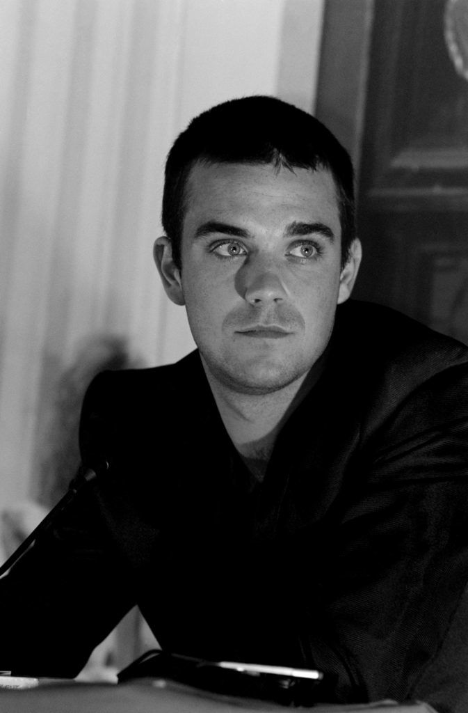 Singer Robbie Williams during his 'Life Thru a Lens' album launch on 30th September 1997. (Photo by Dave Hogan/Hulton Archive/Getty Images)