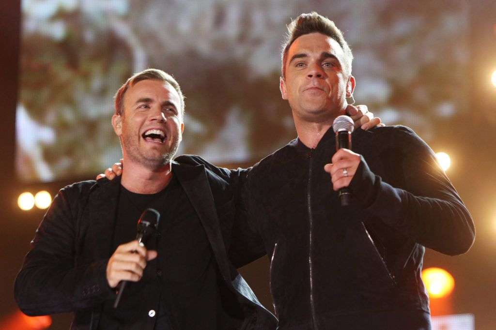 LONDON, ENGLAND - SEPTEMBER 12: L-R Gary Barlow and Robbie Williams perform at the Help The Heroes Concert 2010 held at Twickenham Stadium on September 12, 2010 in London, England. (Photo by Dave J Hogan/Getty Images)