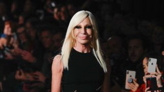 NEW YORK, NEW YORK - DECEMBER 02: Donatella Versace walks the runway at the Versace Pre-Fall 2019 Collection at The American Stock Exchange on December 02, 2018 in New York City. (Photo by JP Yim/Getty Images)