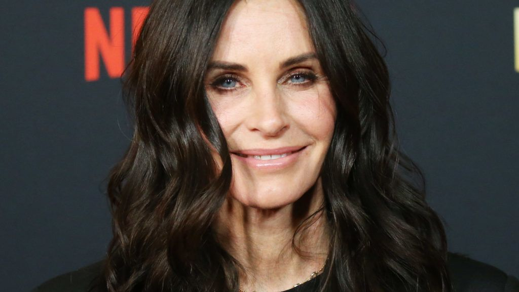 """HOLLYWOOD, CALIFORNIA - DECEMBER 06: Courteney Cox attends the Los Angeles premiere of Netflix's """"Dumplin'"""" held at TCL Chinese Theatre on December 06, 2018 in Hollywood, California. (Photo by Michael Tran/FilmMagic)"""