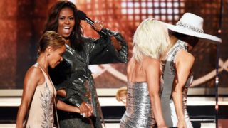 LOS ANGELES, CA - FEBRUARY 10:  (L-R) Jada Pinkett Smith, Michelle Obama, Lady Gaga, and Jennifer Lopez walk onstage during the 61st Annual GRAMMY Awards at Staples Center on February 10, 2019 in Los Angeles, California.  (Photo by Kevin Winter/Getty Images for The Recording Academy)