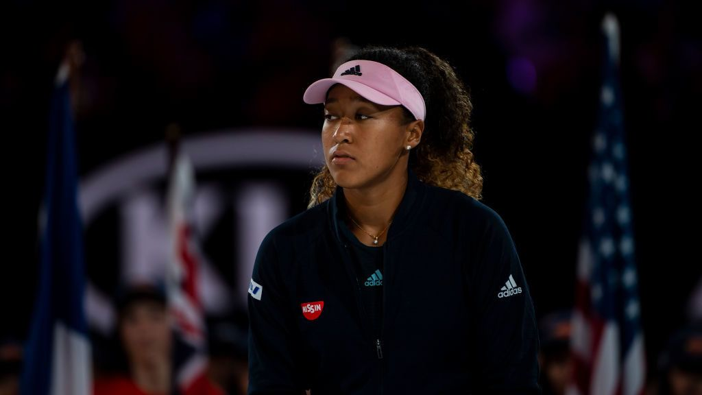 MELBOURNE, AUSTRALIA - JANUARY 26: Naomi Osaka of Japan walks up onto the podium to collect the winner's trophy after beating Petra Kvitova of the Czech Republic in the women's singles final on day 13 of the 2019 Australian Open at Melbourne Park on January 26, 2019 in Melbourne, Australia. (Photo by TPN/Getty Images)