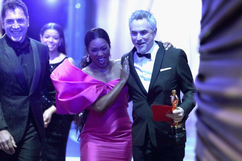 HOLLYWOOD, CA - FEBRUARY 24:  In this handout provided by A.M.P.A.S., presenter Angela Bassett poses with Foreign Language Film winner Alfonso Cuaron backstage during the 91st Annual Academy Awards at the Dolby Theatre on February 24, 2019 in Hollywood, California.  (Photo by Matt Sayles - Handout/A.M.P.A.S. via Getty Images)