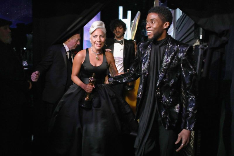 HOLLYWOOD, CA - FEBRUARY 24:  In this handout provided by A.M.P.A.S., Lady Gaga poses with the Music (Original Song) award for 'Shallow' from 'A Star Is Born' backstage with presenter Chadwick Boseman during the 91st Annual Academy Awards at the Dolby Theatre on February 24, 2019 in Hollywood, California.  (Photo by Matt Sayles - Handout/A.M.P.A.S. via Getty Images)