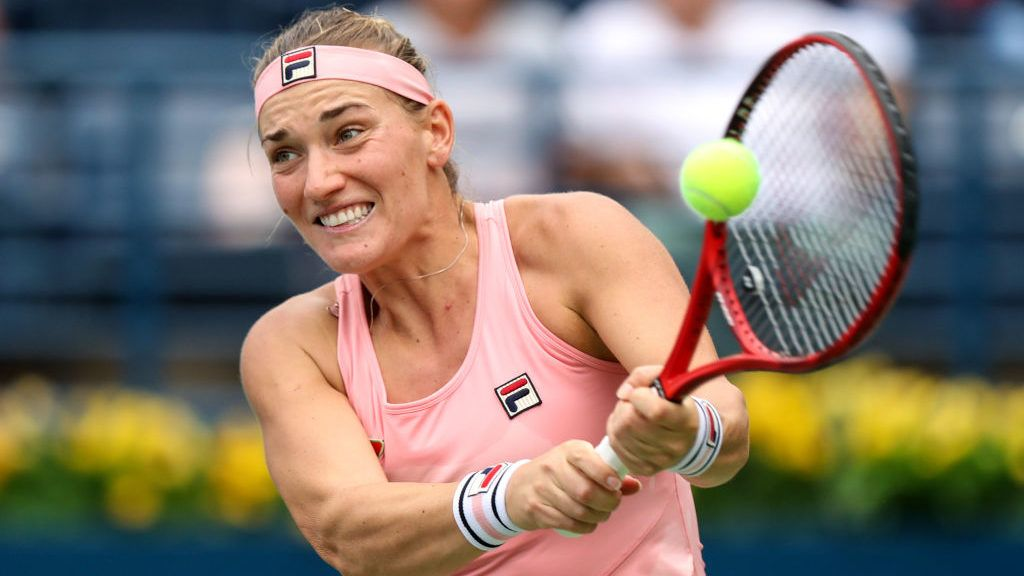 DUBAI, UNITED ARAB EMIRATES - FEBRUARY 17:  Timea Babos of Hungary plays a shot in her match against Alize Cornet of France during day one of the WTA Dubai Duty Free Tennis Championships at Dubai Tennis Stadium on February 17, 2019 in Dubai, United Arab Emirates. (Photo by Francois Nel/Getty Images)