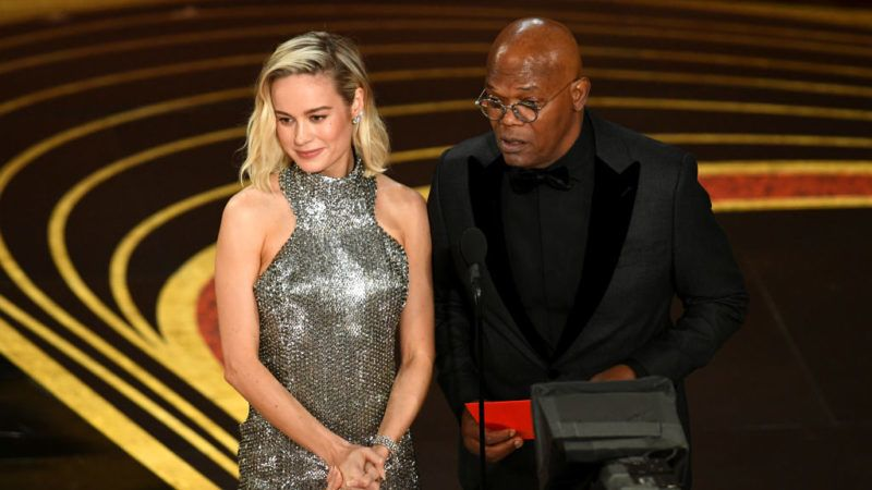 HOLLYWOOD, CALIFORNIA - FEBRUARY 24: (L-R) Brie Larson and Samuel L. Jackson speak onstage during the 91st Annual Academy Awards at Dolby Theatre on February 24, 2019 in Hollywood, California. (Photo by Kevin Winter/Getty Images)