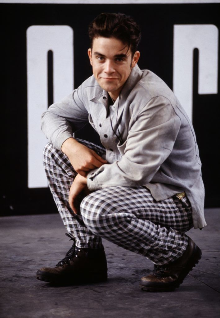 Singer Robbie Williams, of British boy band Take That, at a photoshoot in London, 1990. (Photo by Michael Putland/Getty Images)