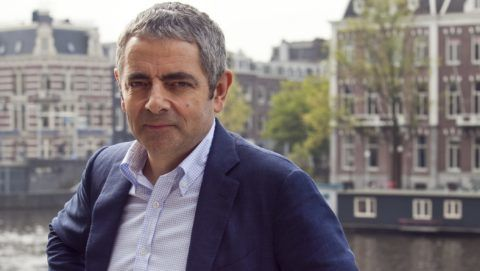 AMSTERDAM, NETHERLANDS - OCTOBER 03:  Rowan Atkinson poses during a photocall to promote Johnny English Reborn at Amstel Hotel on October 3, 2011 in Amsterdam, Netherlands. (Photo by Helene Wiesenhaan/WireImage)
