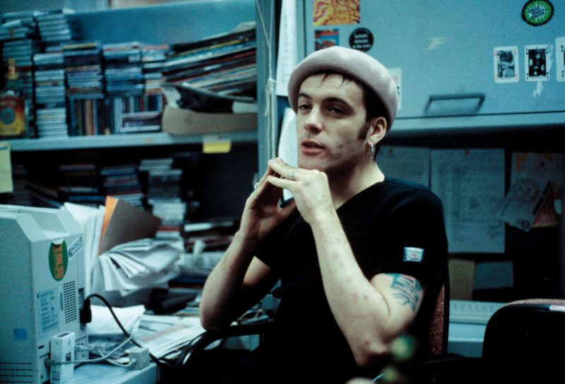 Richey Edwards of the Manic Street Preachers is interviewed in the offices of the NME, London, 1992. (Photo by Martyn Goodacre/Getty Images)