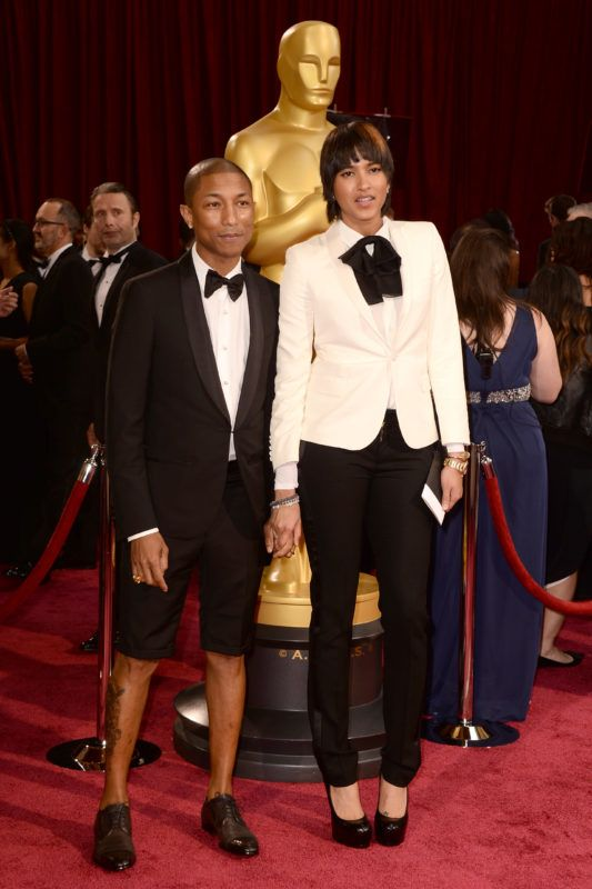 HOLLYWOOD, CA - MARCH 02:  Singer Pharrell Williams and Helen Lasichanh attend the Oscars held at Hollywood & Highland Center on March 2, 2014 in Hollywood, California.  (Photo by Frazer Harrison/Getty Images)