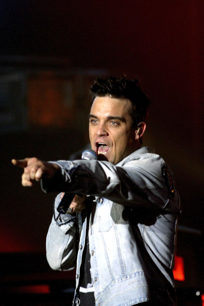 """British singer, Robbie Williams puts in an appearance on Guillaume Durand's television programme """"Traffic"""". (Photo by Eric Fougere/Corbis via Getty Images)"""