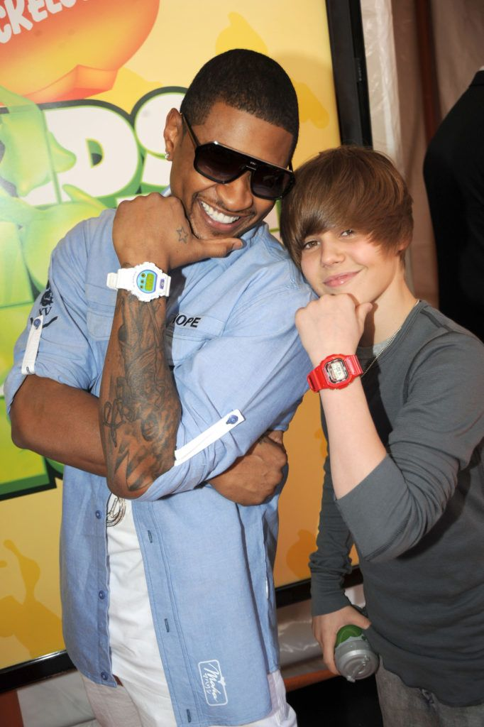 LOS ANGELES, CA - MARCH 28:  Usher and Justin Bieber arrive at Nickelodeon's 2009 Kids' Choice Awards at UCLA's Pauley Pavilion on March 28, 2009 in Westwood, California.  (Photo by Jeff Kravitz/FilmMagic)