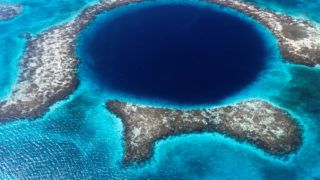 in the barrier reef in belize a cave in formed a great blue hole.