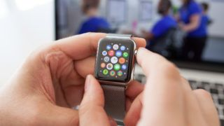 Alushta, Russia - August 29, 2015: Man hand with Apple Watch and app Icon on the screen. Apple Watch was created and developed by the Apple inc.