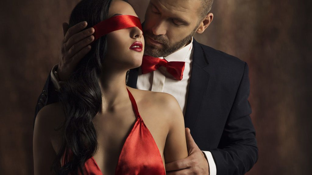 Sexy Couple Love Kiss, Man in Suit Kissing Sensual Woman, Red Fashion Blindfold on Girl Eyes