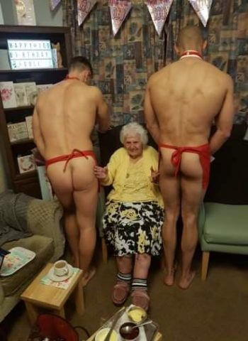 Doll Jenkins, 100 celebrating her 100th birthday in style with half naked hunks at Milton Lodge in Colchester, Essex. See SWNS copy SWCAhunks: A great-great-grandmother was given an extra-special treat for her 100th birthday - a couple of naked hunks. Doll Jenkins' cheeky birthday wishes were fulfilled when staff at her retirement home hired the buff butlers for her very special birthday party. Residents at Milton Lodge made international news last year after residents requested the naked hunks to come and serve a three-course meal. ***EXCLUSIVE***