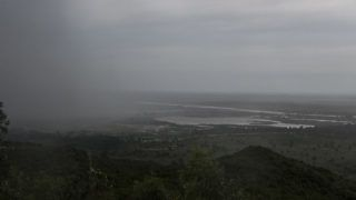 Rain, which is believed to be the beginning of Tropical cyclone Idai coming from central Mozambique, falls in the flooded districts of Chikwawa and Nsanje in southern Malawi, on March 15, 2019. - At least 56 people have died in flood-hit areas as of March 13, according to the government, while 577 had been injured and almost 83,000 people have been displaced. (Photo by AMOS GUMULIRA / AFP)