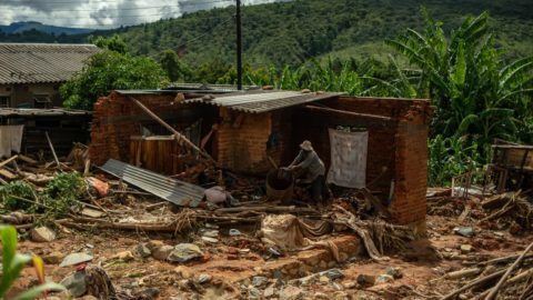 A man cleans up a destroyed house on March 19, 2019 in Chimanimani, as a hundred houses were damaged by the Cyclone Idai. - More than a thousand people are feared to have died in Mozambique alone while scores have been killed and more than 200 are missing in neighbouring Zimbabwe following the deadliest cyclone to hit southern Africa. Cyclone Idai tore into the centre of Mozambique on March 14 night before barreling on to neighbouring Zimbabwe, bringing flash floods and ferocious winds, and washing away roads and houses. (Photo by ZINYANGE AUNTONY / AFP)