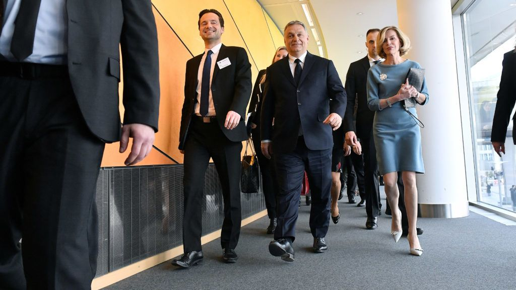 Hungary's Prime Minister Victor Orban (C) arrives for a European People's Party (EPP) meeting at the European Parliament in Brussels on March 20, 2019. - The Fidesz party of firebrand Hungarian Prime Minister Viktor Orban will be hit with a temporary suspension from the European People's Party, EPP sources said on March 20, 2019. Fidesz had faced expulsion after running a controversial billboard campaign that accused European Commission head Jean-Claude Juncker and liberal US billionaire George Soros, a bete-noir of Orban, of plotting to flood Europe with migrants. (Photo by EMMANUEL DUNAND / AFP)