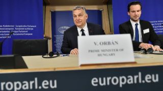 Hungary's Prime Minister Victor Orban (L) addresses a press conference at the end of a European People's Party (EPP) meeting at the European Parliament in Brussels on March 20, 2019. - The Fidesz party of firebrand Hungarian Prime Minister Viktor Orban was hit with a temporary suspension from the European People's Party. Fidesz had faced expulsion after running a controversial billboard campaign that accused European Commission head Jean-Claude Juncker and liberal US billionaire George Soros, a bete-noir of Orban, of plotting to flood Europe with migrants. (Photo by EMMANUEL DUNAND / AFP)