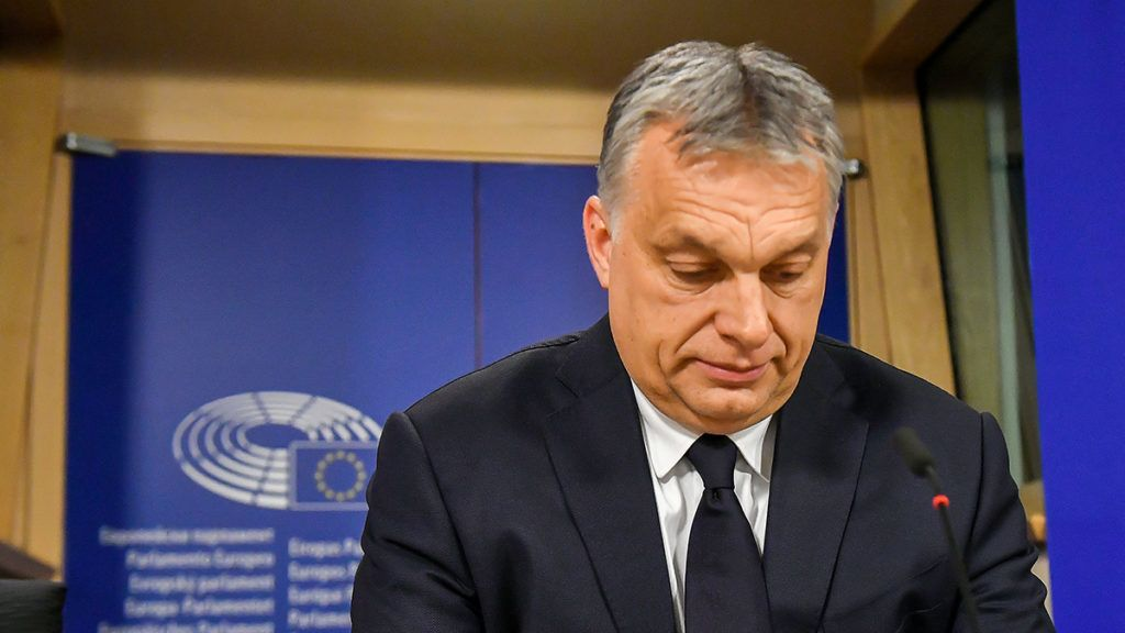 Hungary's Prime Minister Victor Orban addresses a press conference at the end of a European People's Party (EPP) meeting at the European Parliament in Brussels on March 20, 2019. - The Fidesz party of firebrand Hungarian Prime Minister Viktor Orban was hit with a temporary suspension from the European People's Party. Fidesz had faced expulsion after running a controversial billboard campaign that accused European Commission head Jean-Claude Juncker and liberal US billionaire George Soros, a bete-noir of Orban, of plotting to flood Europe with migrants. (Photo by EMMANUEL DUNAND / AFP)