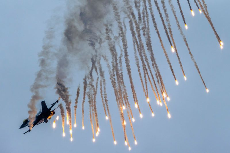 Dutch pilot of Demo Team shoots some flares as he demonstrates his skills with his F-16 at the Slovak International Air Fest SIAF 2014 at the Slovak Airforce Base of Sliac on August 30, 2014. AFP PHOTO/JOE KLAMAR (Photo by JOE KLAMAR / AFP)