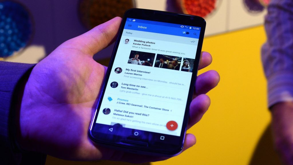 """Google's lead designer for """"Inbox by Gmail"""" Jason Cornwell shows the app's functionalities on a nexus 6 android phone during a media preview in New York on October 29, 2014. Google ramped up its mobile arsenal, upgrading its Nexus line with a new tablet and smartphone, and unveiling its revamped Android software, to be dubbed """"Lollipop."""" The US tech giant also announced the launch of a streaming media player for music, movies and videos, which can also allow users to play games via the Android TV device. AFP PHOTO/Jewel Samad (Photo by JEWEL SAMAD / AFP)"""