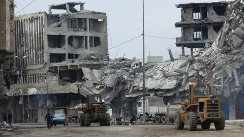 Two bulldozers are seen near a collapsed building in Mosul, Iraq, on Jan. 4, 2018. Mosul was taken control by the Islamic State in June 2014 and suffered tremendous damage during the fight between Iraqi army and extremists, and was finally liberated by Iraqi army in July 2017. (/Khalil Dawood) (whw)