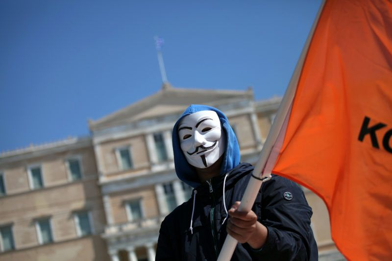 A man with a Guy Fawkes mask during a protest against the implemented EU Copyright Directive (known as ACTA 2.0) in Athens, Greece on March 23, 2019. On September an updated version of the articles 11 and 13 of the Directive on Copyright in the Digital Single Market were approved by the European Parliament. EU claims that article 11 and 13 aim to protect the copyrights and to bring profits to news outlets, artists and others when social media platforms such as Google, Facebook and others link their work. (Photo by Giorgos Georgiou/NurPhoto)
