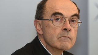 (FILES) In this file photo taken on March 15, 2016 Roman Catholic Cardinal Philippe Barbarin, Archbishop of Lyon looks on during the Conference of Bishops of France held at the Saint Bernadette hemicycle in Lourdes, southwestern France. - The archbishop of Lyon, the most senior French Catholic cleric caught up in the paedophilia scandals that have rocked the church, was convicted of helping covering up abuse and handed a six-month suspended jail term on March 7, 2019. (Photo by ERIC CABANIS / AFP)
