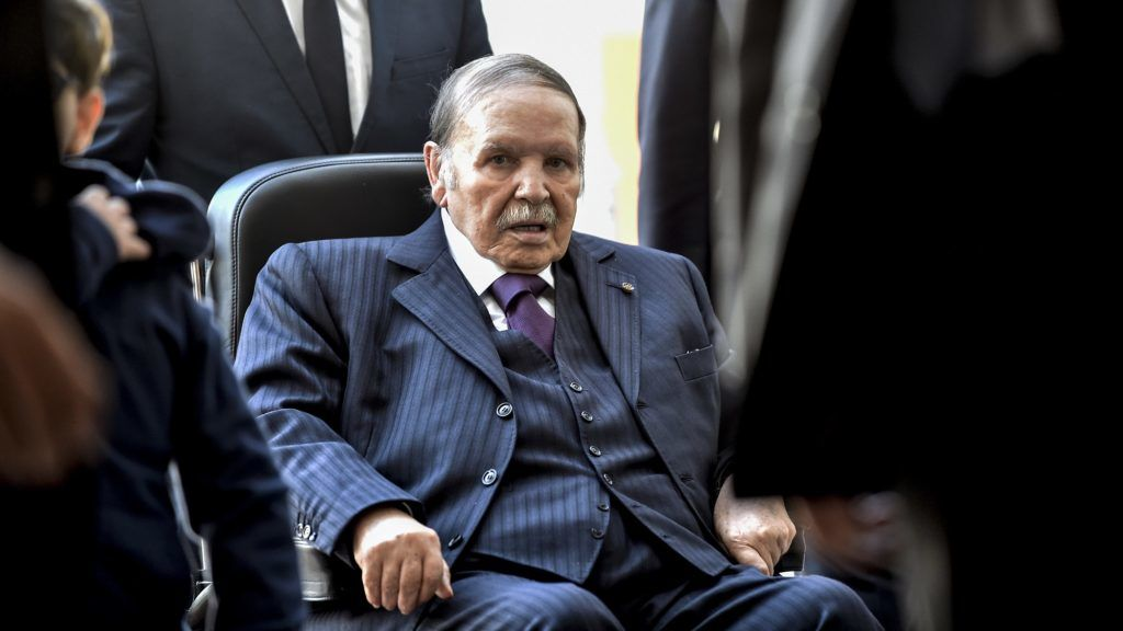 (FILES) In this file photo taken on November 23, 2017, Algerian President Abdelaziz Bouteflika is seen while voting at a polling station in the capital Algiers during polls for local elections. - Algeria's President Abdelaziz Bouteflika announced on March 11, 2019 his withdrawal from a bid to win another term in office and postponed an April 18 election, following weeks of protests against his candidacy. Bouteflika, in a message carried by national news agency APS, said the presidential poll would follow a national conference on political and constitutional reform to be drawn up by the end of 2019. (Photo by RYAD KRAMDI / AFP)