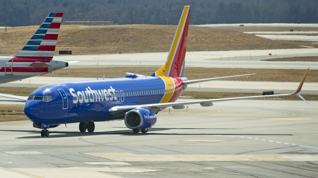 A Boeing 737 Max 8 flown by Southwest Airlines taxis to the gate at Baltimore Washington International Airport near Baltimore, Maryland on March 13, 2019. - As US authorities continued to resist pressure Wednesday to ground the Boeing 737 MAX following the latest deadly crash, reports from American pilots surfaced who reported issues with the plane late last year. At least four pilots made reports following the October crash of a Lion Air flight in Indonesia shortly after takeoff, all complaining that the aircraft suddenly pitched downward, according to documents reviewed by AFP on a flight safety database. (Photo by Jim WATSON / AFP)