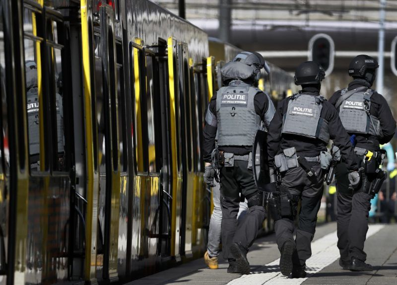 Police forces walk near a tram at the 24 Oktoberplace in Utrecht, on March 18, 2019 where a shooting took place. - A gunman who opened fire on a tram in the Dutch city of Utrecht on March 18, injuring several people, is on the run, police said. Police only spoke of one gunman but did not rule out the possibility there might be others, the ANP news agency quoted police as saying. (Photo by Robin van Lonkhuijsen / ANP / AFP) / Netherlands OUT