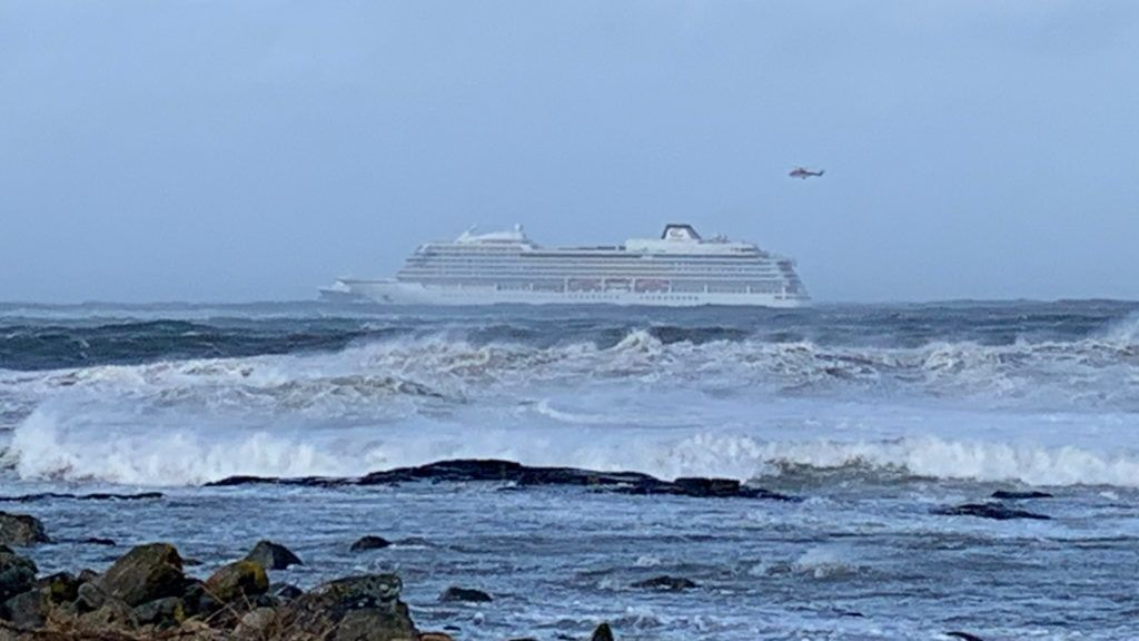 "The cruise ship Viking Sky is pictured on March 23, 2019 near the west coast of Norway at Hustadvika near Romsdal. - Emergency services said on March 23, 2019 they were airlifting 1,300 passengers off a cruise ship off the Norwegian coast. The Viking Sky cruise ship sent an SOS message due to ""engine problems in bad weather"", southern Norway's rescue centre said on Twitter, while police reported the passengers would be evacuated by helicopter. (Photo by Odd Roar LANGE / NTB Scanpix / AFP) / Norway OUT"