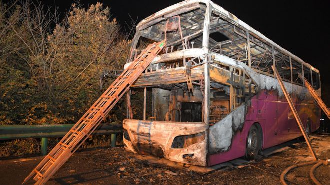 (190323) -- CHANGDE, March 23, 2019 (Xinhua) -- Photo taken on March 22, 2019 shows the accident site of a coach fire in Changde, central China's Hunan Province. Twenty-six people were killed and 28 others injured after a tour coach caught fire in central China's Hunan Province on Friday, local authorities said.    The injured, including five in critical condition, were rushed to three local hospitals for treatment, according to the publicity department of the Hunan Provincial Committee of the Communist Party of China.     The accident happened around 19:15 on Friday evening when the 59-seater bus from neighboring Henan province suddenly caught fire on a highway in Hanshou County in the city of Changde. There were 56 people on board, including 53 passengers, two drivers and a tour guide.     The two drivers were detained and an investigation into the cause of the accident is under way. (Xinhua/Chen Zeguo)