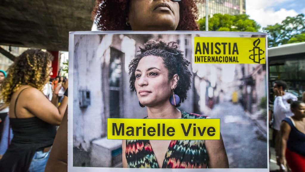 People gather in Paulista Avenue, Sao Paulo, Brazil on April 14, 2018 during a demonstration marking one month of activist Marielle Franco's murder. The murder of Franco, a black Brazilian activist who fought her way out of the slums to become a popular councilor, made headlines around the world. The outspoken 38-year-old, who was a critic of police brutality, an advocate for minorities and the posterchild of a new type of politics, was shot dead on March 14 in an assassination-style killing with four bullets to the head. (Photo by Cris Faga/NurPhoto)