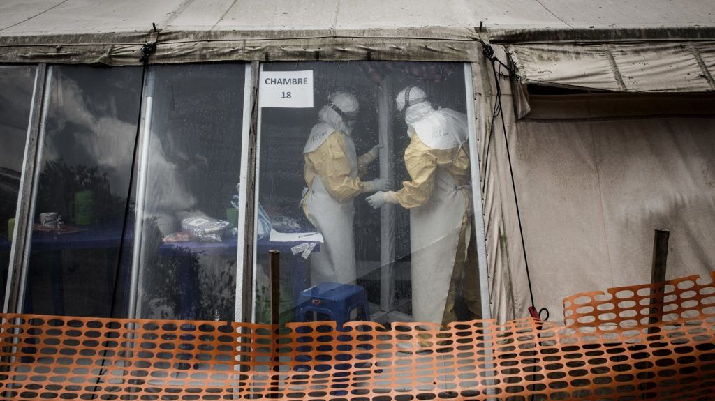 Health workers are seen inside the 'red zone' of an Ebola treatment centre, which was attacked in the early hours of the morning on March 9, 2019 in Butembo. - Armed men on March 9 attacked an Ebola treatment centre in the east of the Democratic Republic of Congo, killing a policeman and wounding a health worker, the authorities said. Suspected Mai-Mai rebels have attacked the Butembo ETC twice in the last two weeks. (Photo by JOHN WESSELS / AFP)