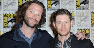 """SAN DIEGO, CA - JULY 22:  Jared Padalecki (L) and Jensen Ackles attend the """"Supernatural"""" special video presentation and Q&A during Comic-Con International 2018 at San Diego Convention Center on July 22, 2018 in San Diego, California.  (Photo by Albert L. Ortega/Getty Images)"""