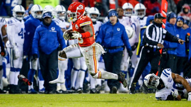 KANSAS CITY, MO - JANUARY 12: Tyreek Hill #10 of the Kansas City Chiefs loses a shoe after breaking away from the tackle attempt of Anthony Walker #50 of the Indianapolis Colts during the third quarter of the AFC Divisional Round playoff game at Arrowhead Stadium on January 12, 2019 in Kansas City, Missouri. (Photo by David Eulitt/Getty Images)