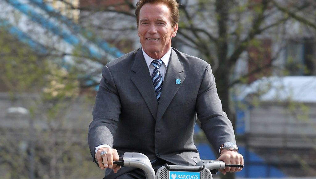 LONDON, UNITED KINGDOM - MARCH 31:  Former Governor of California Arnold Schwarzenegger cycles on a London Cycle Hire bike in front of City Hall on March 31, 2011 in London, England. London Mayor Boris Johnson today met with Mr Schwarzenegger to exchange ideas on how to encourage low and zero emission technologies. (Photo by Fred Duval/Getty Images)