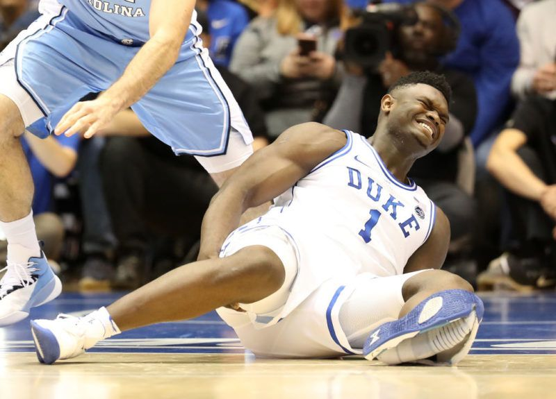 DURHAM, NORTH CAROLINA - FEBRUARY 20: (EDITORS NOTE: Retransmission with alternate crop.) Zion Williamson #1 of the Duke Blue Devils reacts after falling as his shoe breaks against Luke Maye #32 of the North Carolina Tar Heels during their game at Cameron Indoor Stadium on February 20, 2019 in Durham, North Carolina. (Photo by Streeter Lecka/Getty Images)