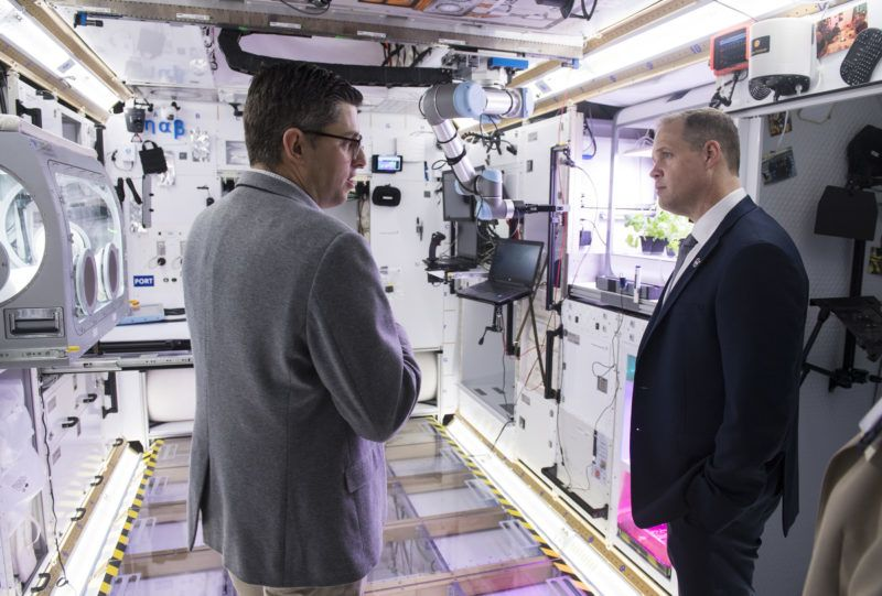 CAPE CANAVERAL, FL - MARCH 11: In this handout photo provided by NASA, Bill Pratt, Lockheed Martin NextSTEP program manager gives NASA Administrator Jim Bridenstine a tour of the Lockheed Martin Gateway habitat prototype in the Space Station Processing Facility High Bay, after an event to discuss NASAs progress toward sending astronauts to the Moon and on to Mars during a televised event at the Neil Armstrong Operations and Checkout Building at NASA's Kennedy Space Center on March 11, 2019 in Cape Canaveral, Florida.  NASA's Orion spacecraft, which is scheduled to be flown on Exploration Mission-2, was on display during the event. (Photo by Aubrey Gemignani/NASA via Getty Images)